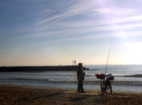 Man fishing off the Mediterranean Coast of Spain