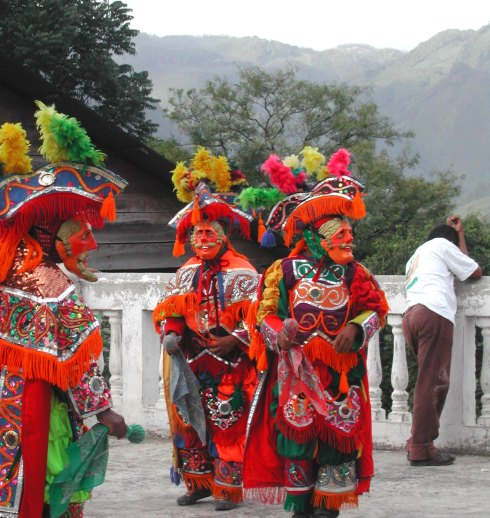 Brightly colored costumes of traditional Guetamalan festivities