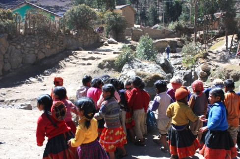 Children playing outside of a school in the Lares Valley of Peru