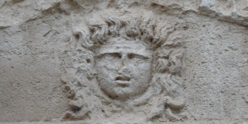 Photo of a carved face within a ruin in Olympos