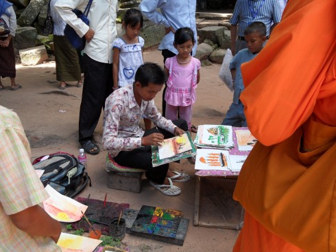 Cambodian artist outside Ta Prohm