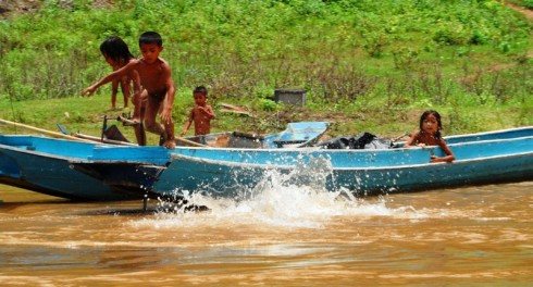 Color photo of children playing on the Mekong