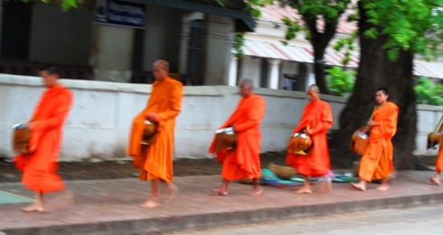 Monks walking through the streets of Luang Prabang