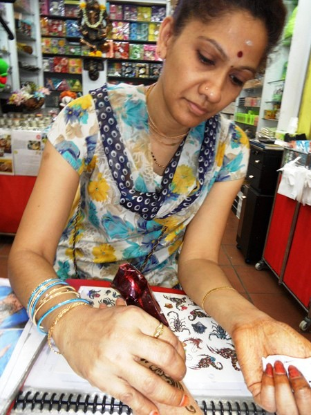 Henna artist in Little India