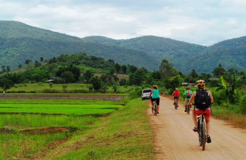 Color photo biking through the country side in Chiang Rai Thailand