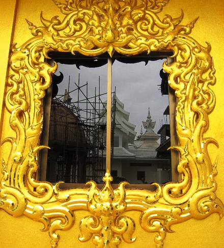 color photo at the golden temple reflection in a window