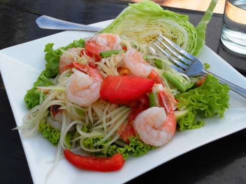 color photo of a papaya and shrimp salad
