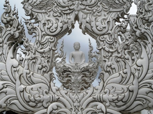color photo of white buddha statue in Thailand