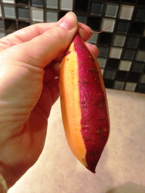 Partially peeled sweet potato